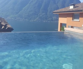 Lago di Como Penthouse with fantastic panoramic lake view, hammam, gym, private swimming pool and garden