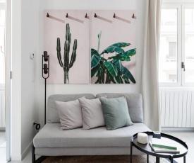 Elegante appartamento minimal dai tocchi botanici